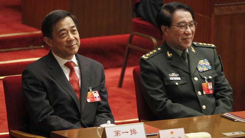 In this March 14, 2012 file photo, Xu Caihou, right, deputy chairman of the CPC Central Military Commission, which controls China's military, and Chongqing party secretary Bo Xilai attend the closing session of the National People's Congress at the Great