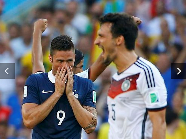 France's Olivier Giroud (C) reacts past Germany's Mats Hummels after their 2014 World Cup quarter-finals soccer match at the Maracana stadium in Rio de Janeiro July 4, 2014.