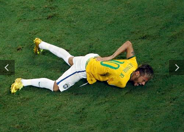Brazil's Neymar grimaces after a challenge by Colombia's Camilo Zuniga (unseen) during their 2014 World Cup quarter-finals against Colombia at the Castelao arena in Fortaleza July 4, 2014.
