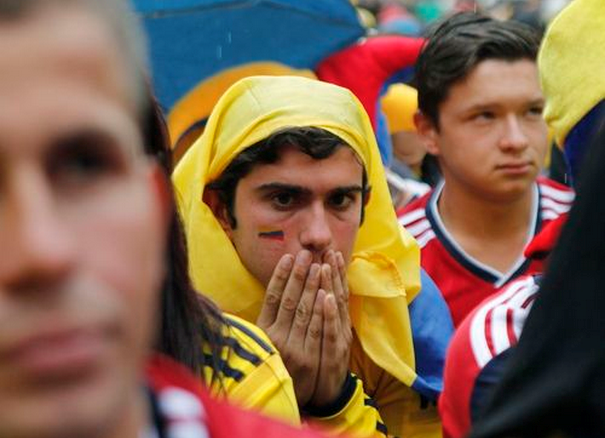 A Colombian fan reacts after Colombia was defeated by Brazil in their World Cup quarter-final match, at a public viewing in Bogota July 4, 2014.