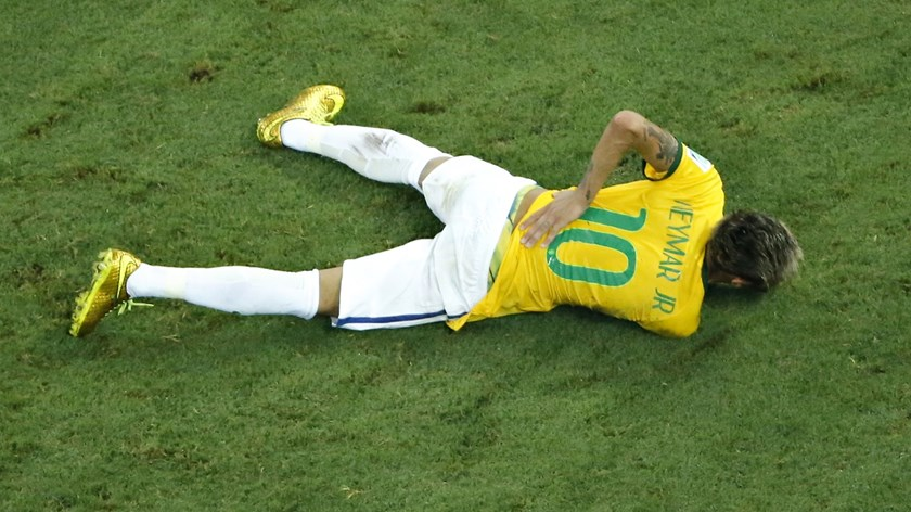 Brazil's Neymar grimaces in pain after a challenge by Colombia's Camilo Zuniga during their 2014 World Cup quarter-final match at the Castelao arena in Fortaleza July 4, 2014.