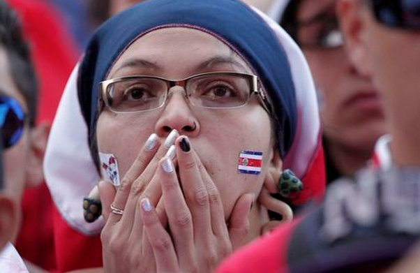 A Costa Rica fan reacts during a public screening of their 2014 World Cup quarter-final soccer match against the Netherlands, at Democracia Square in San Jose July 5, 2014.