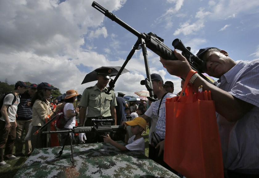 China army charms Hong Kongers amid unease over presence