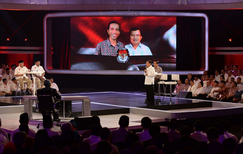 Jusuf Kalla, vice presidential candidate, speaks next to Joko Widodo, governor of Jakarta and his running mate as presidential candidate, during a debate against opponents Prabowo Subianto, presidential candidate, second from left, and Hatta Rajasa, vice
