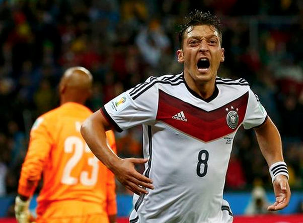 Germany's Mesut Ozil celebrates scoring a goal against Algeria during extra time in their 2014 World Cup round of 16 game at the Beira Rio stadium in Porto Alegre June 30, 2014.
