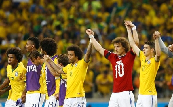 Brazil's David Luiz, wearing Colombia's James Rodriguez's jersey, celebrates with teammates after their 2014 World Cup quarter-finals at the Castelao arena in Fortaleza July 4, 2014.