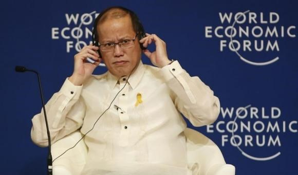 Philippine President Benigno Aquino listens on his headset during the opening plenary session of the World Economic Forum on East Asia, at Manila's Makati financial district May 22, 2014.