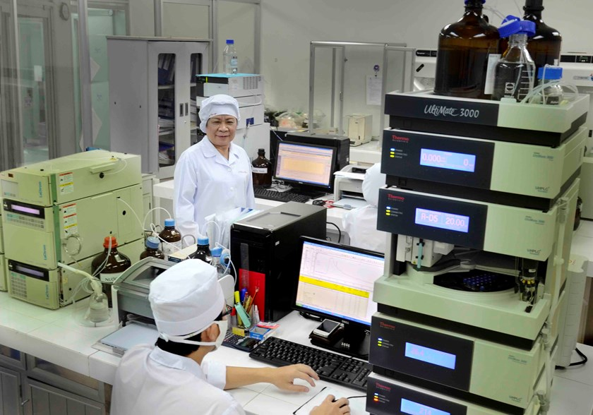 DHG Pharmaceutical JSC Chief Executive Officer Pham Thi Viet Nga (L) visits a factory in southern Vietnam