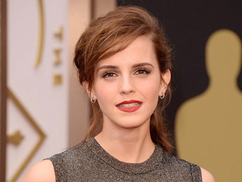 Actress Emma Watson attends the Oscars 2013