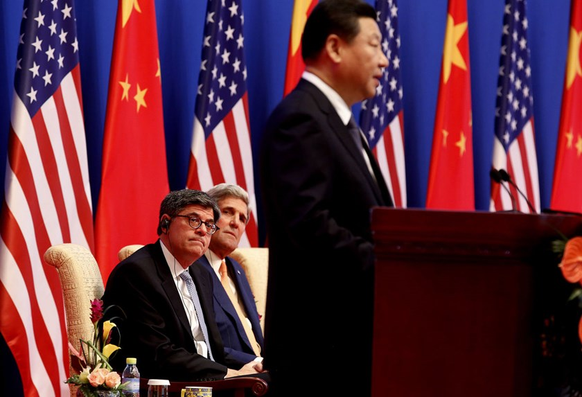 Jack Lew, U.S. treasury secretary, left, and John Kerry, U.S. secretary of state, center, listen as Xi Jinping, China's president, addresses a Joint Opening Session of the U.S.-China Strategic and Economic Dialogue at the Diaoyutai State Guesthouse in Bei