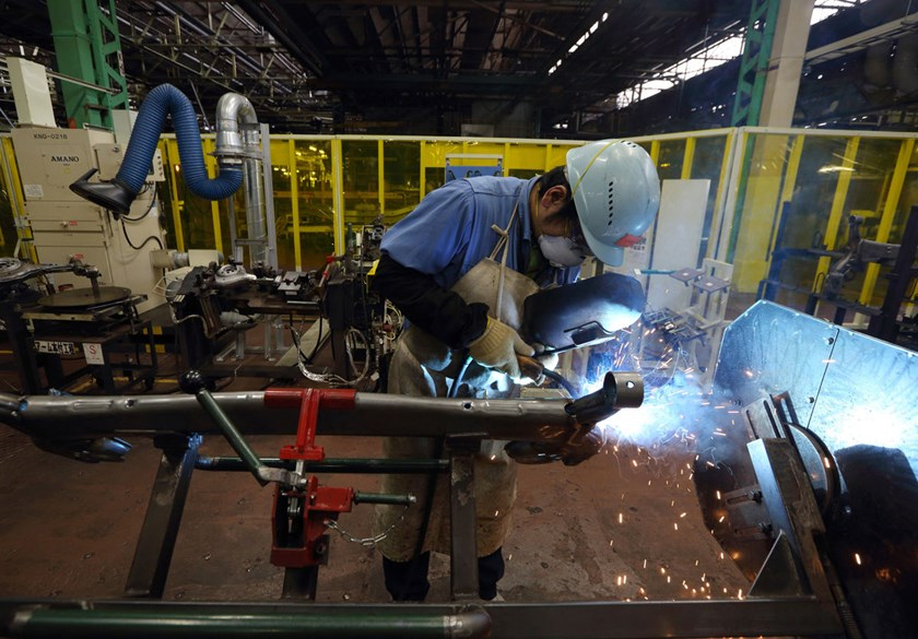A worker welds an automobile part in the chassis manufacturing department at a Toyota Motor Corp. plant in Toyota City, Aichi Prefecture, Japan.