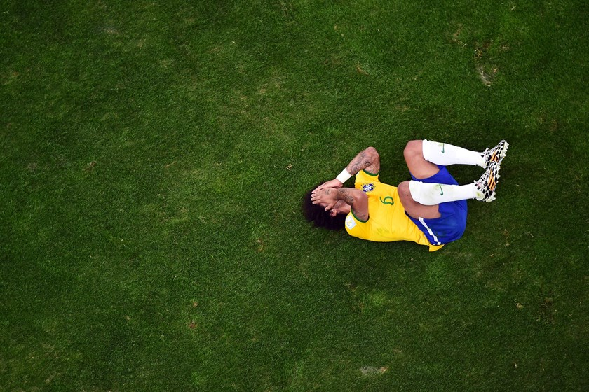 Marcelo of Brazil reacts during the 2014 FIFA World Cup Brazil Semi Final match between Brazil and Germany at Estadio Mineirao on July 8, 2014.