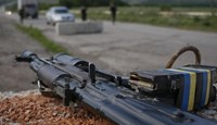 A weapon and magazines loaded with bullets are pictured at a position where Ukrainian soldiers are standing guard near the eastern Ukrainian city of Konstantinovka July 10, 2014.