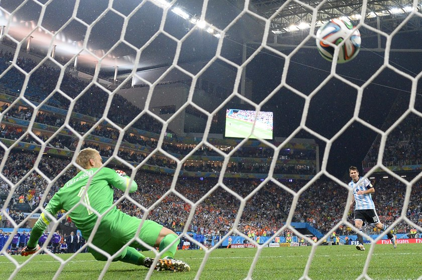 Netherlands' goalkeeper failed to make a save from Argentina's forward and captain Lionel Messi during a penalty shoot out following extra-time in the semi-final football match between Netherlands and Argentina of the FIFA World Cup in Sao Paulo on July 9