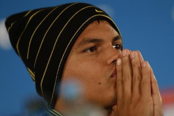 Brazil's national soccer team player Thiago Silva pauses during a news conference at Mane Garrincha National stadium in Brasilia, July 11, 2014.