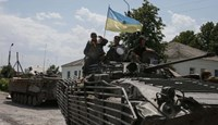 Ukrainian troops are pictured in the eastern Ukrainian town of Seversk July 12, 2014.