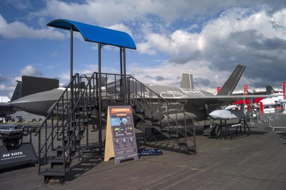 An F-35 life-size model aircraft is displayed at the 2014 Farnborough International Airshow in Farnborough, southern England July 13, 2014.