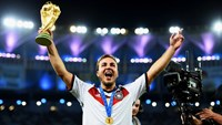 Mario Goetze of Germany holds up the World Cup trophy after the 1-0 win in the 2014 FIFA World Cup Brazil Final match between Germany and Argentina at Maracana on July 13, 2014.