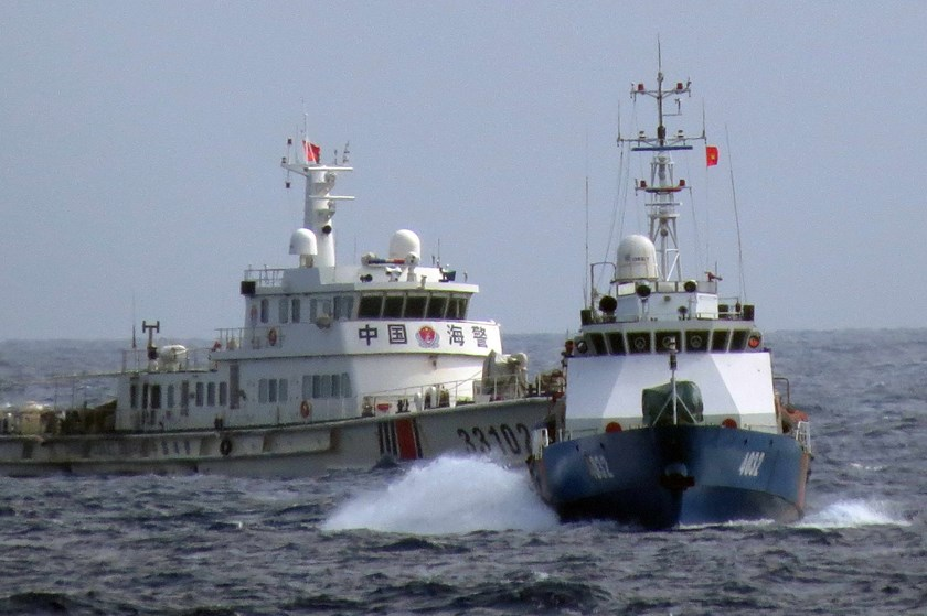 A Chinese ship harasses a Vietnamese government boat operating in waters well within Vietnam's exclusive economic zone, near an oil rig that China places just 150 nautical miles off Vietnam's coast.
