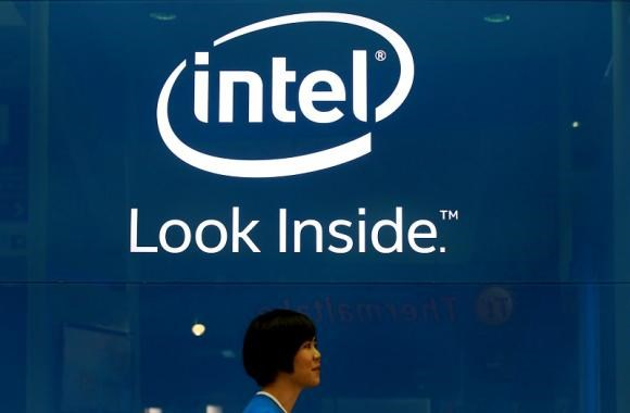 An employee walks past an Intel logo during the 2014 Computex exhibition at the TWTC Nangang exhibition hall in Taipei June 3, 2014.