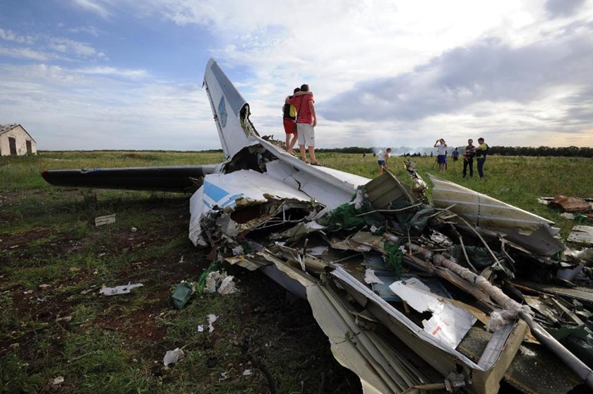 Wreckage of a Ukrainian AN-26 military transport plane in the village of Davydo-Mykilske, east of Lougansk on July 14, 2014 after it was shot down by a missile