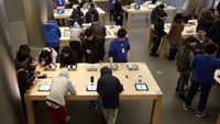 Customers try Apple products, including the iPhone, at the company's store in Beijing on March 12, 2013. Apple's Wangfujing store is the largest in Asia.