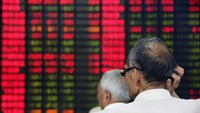 Customers look at an electronic stock board at a securities firm in Shanghai, China.