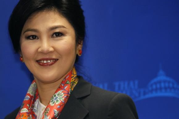Thailand's Prime Minister Yingluck Shinawatra smiles as she arrives to address reporters in Bangkok in this May 7, 2014 file photo.