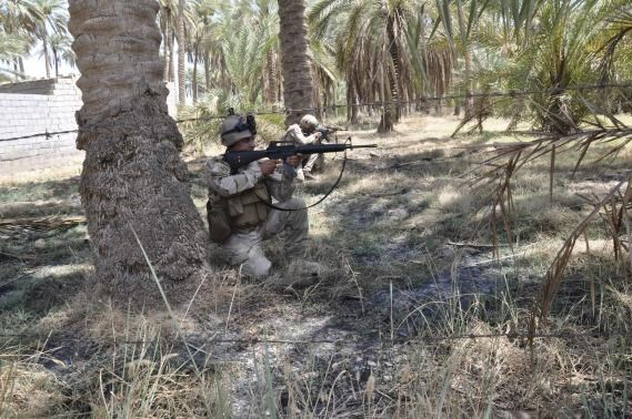 Members of the Iraqi security forces take their positions during a patrol in the town of Jurf al-Sakhar, south of Baghdad, July 16, 2014. Picture taken July 16 2014.