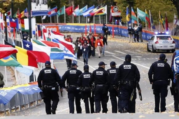 New York Police Department counter-terrorism officers patrol the course near the finish line area in Central Park before the start of the New York City Marathon in New York, November 3, 2013.