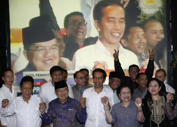 Indonesian presidential candidate Joko ''Jokowi'' Widodo (C) and his running mate Jusuf Kalla (2nd L) celebrate with the head of his party, former president Megawati Sukarnoputri (2nd R) and her daughter Puan Maharani, ahead of the official results announ