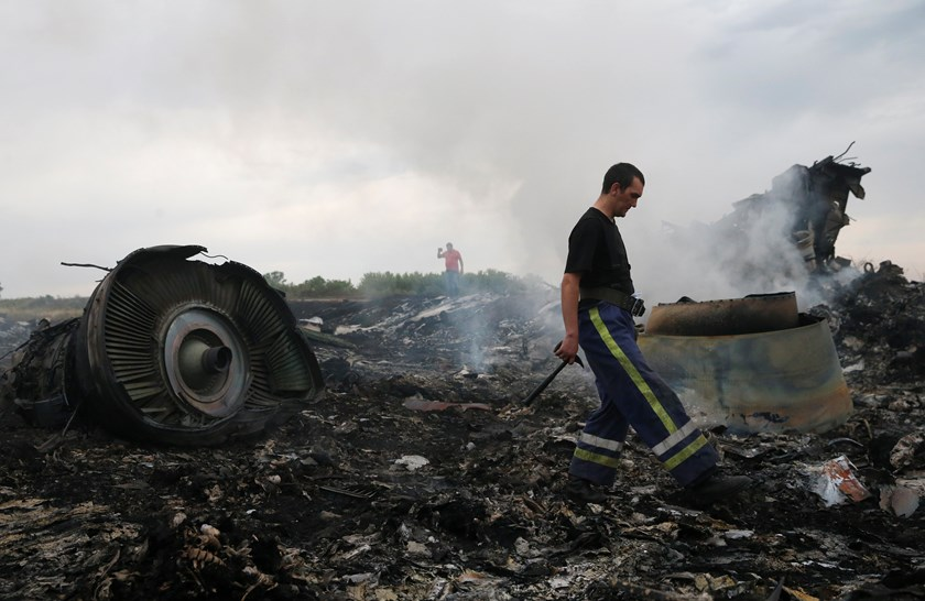 An Emergencies Ministry member walks at a site of a Malaysia Airlines Boeing 777 plane crash near the settlement of Grabovo in the Donetsk region, July 17, 2014.