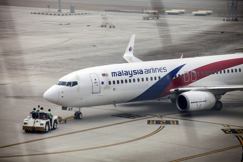 A Boeing Co. 737-800 aircraft operated by Malaysian Airline System Bhd. is pushed back off the gate at Kuala Lumpur International Airport on March 14, 2014.