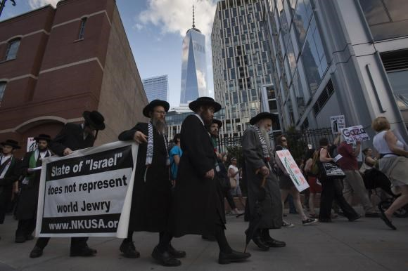 One World Trade Center is seen in the background during a protest march demanding an end to the recent Israeli-Palestinian violence through Lower Manhattan, New York, July 24, 2014.
