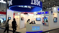 Visitors walk past the IBM booth at the 9th China International Software Product & Information Service Expo in Nanjing, Jiangsu province September 6, 2013.