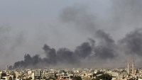 Black plumes of smoke is seen in the vicinity of Camp Thunderbolt, after clashes between militants, former rebel fighters and government forces in Benghazi July 26, 2014.