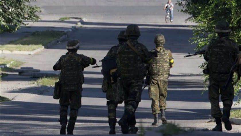 Ukrainian government army soldiers patrol in the city of Lisichansk, Luhansk region, eastern Ukraine Saturday, July 26, 2014.