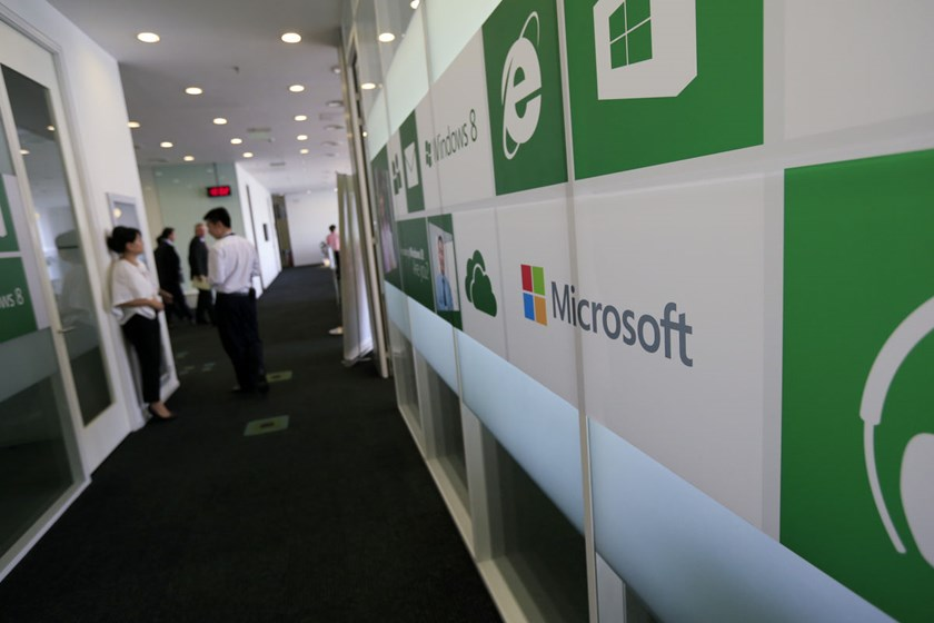 Employees work inside Microsoft Corp.'s China headquarters in Beijing, China.
