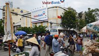 A Vietnam Joint Stock Commercial Bank for Industry and Trade (VietinBank) branch stands near the Binh Tay market in Chinatown in Ho Chi Minh City.
