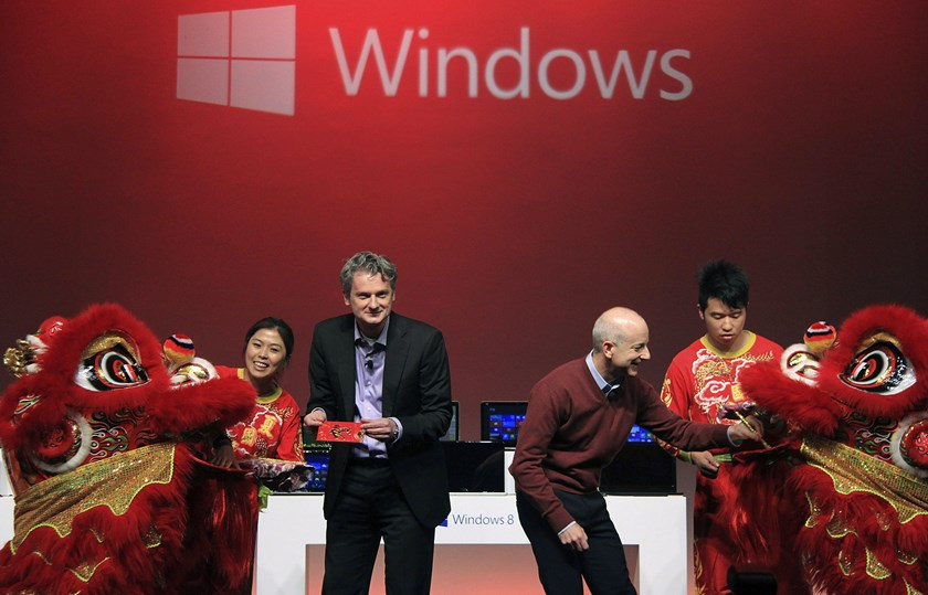 Ralph Haupter, left, chief executive officer of Microsoft Corp.'s greater China region operations, and Steven Sinofsky, then president of Microsoft's Windows division, attend a promotion event of the new Windows 8 software in Shanghai in this Oct. 23, 201