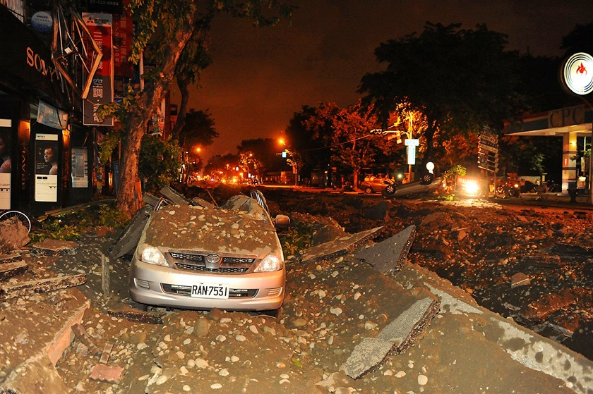 Wreckage of a damaged car is pictured after an explosion in Kaohsiung, southern Taiwan, August 1, 2014.