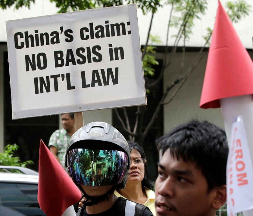 "Protesters display placards and mock missiles at the Chinese Consulate in Manila, Philippines. Various civil society groups, in simultaneous protests at Chinese Embassies and consular offices around the world, renewed their calls against China's ""bullying"