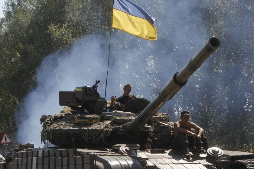 Ukrainian soldiers ride on a tank as they patrol the area near eastern Ukrainian town of Debaltseve August 3, 2014.