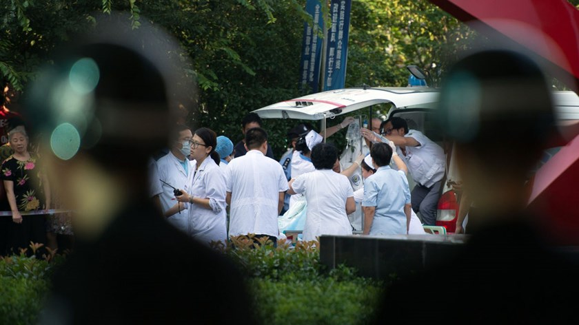 Doctors and nurses rush a victim of a factory explosion for treatment at a hospital in Kunshan, on August 2, 2014.