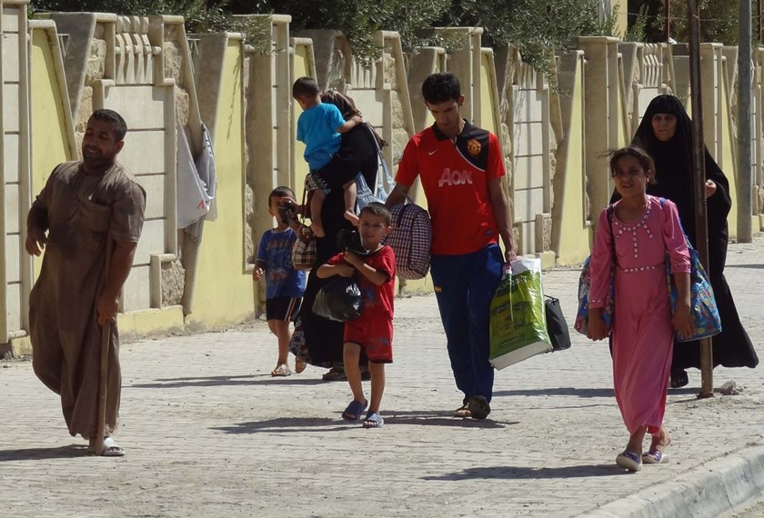 Iraqis displaced by ongoing conflict in nearby areas arrive in the northern Kurdish controlled Iraqi city of Kirkuk.
