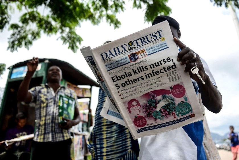 A man reads news on the Ebola virus in Abuja, Nigeria, on August 7, 2014.