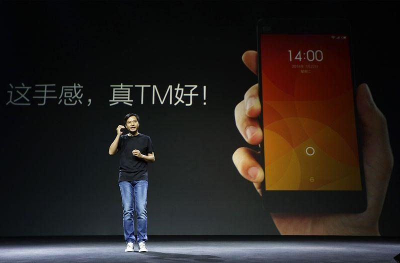 Lei Jun, founder and CEO of China's mobile company Xiaomi, speaks at a launch ceremony of Xiaomi Phone 4, in Beijing, July 22, 2014.