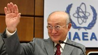 International Atomic Energy Agency (IAEA) Director General Yukiya Amano waves as he arrives for a board of governors meeting at the IAEA headquarters in Vienna June 4, 2014.