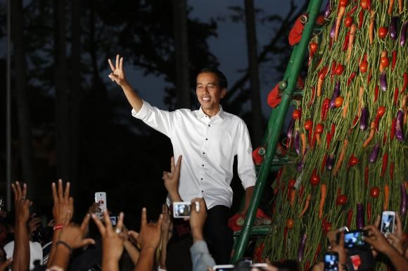 Indonesia's presidential candidate Joko ''Jokowi'' Widodo gestures to supporters a day after he was named winner in the presidential election in Taman Proklamasi, Jakarta July 23, 2014.
