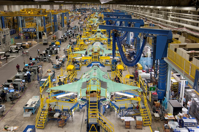 Workers can be seen on the moving line and forward fuselage assembly areas for the F-35 Joint Strike Fighter at Lockheed Martin Corp's factory located in Fort Worth, Texas in this October 13, 2011 handout photo provided by Lockheed Martin.